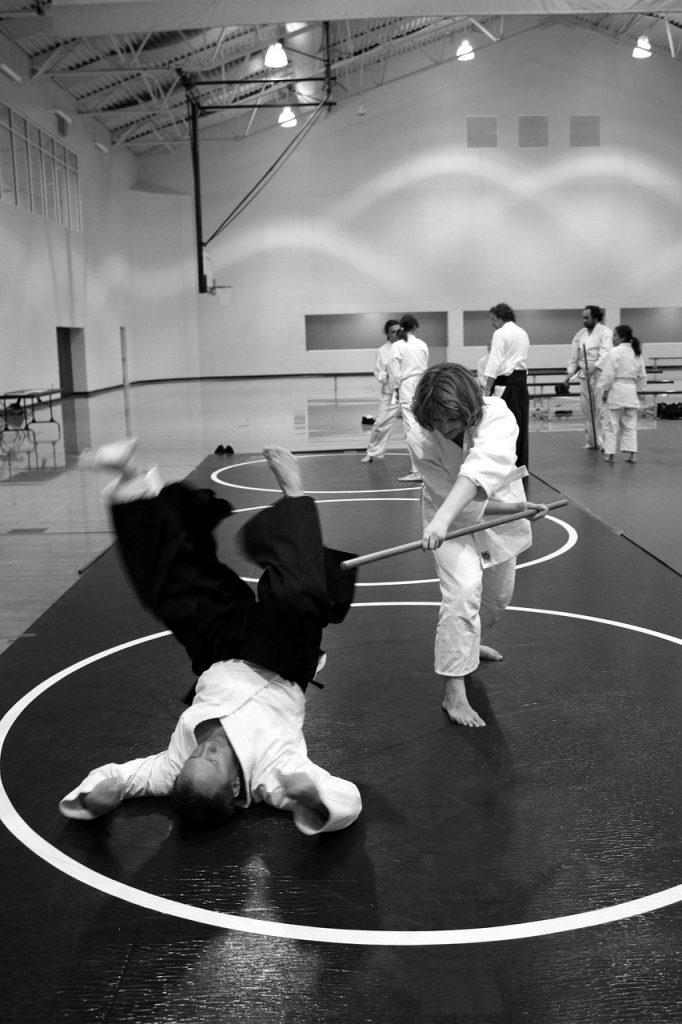 Combat de aïkido, art martial, sport en A